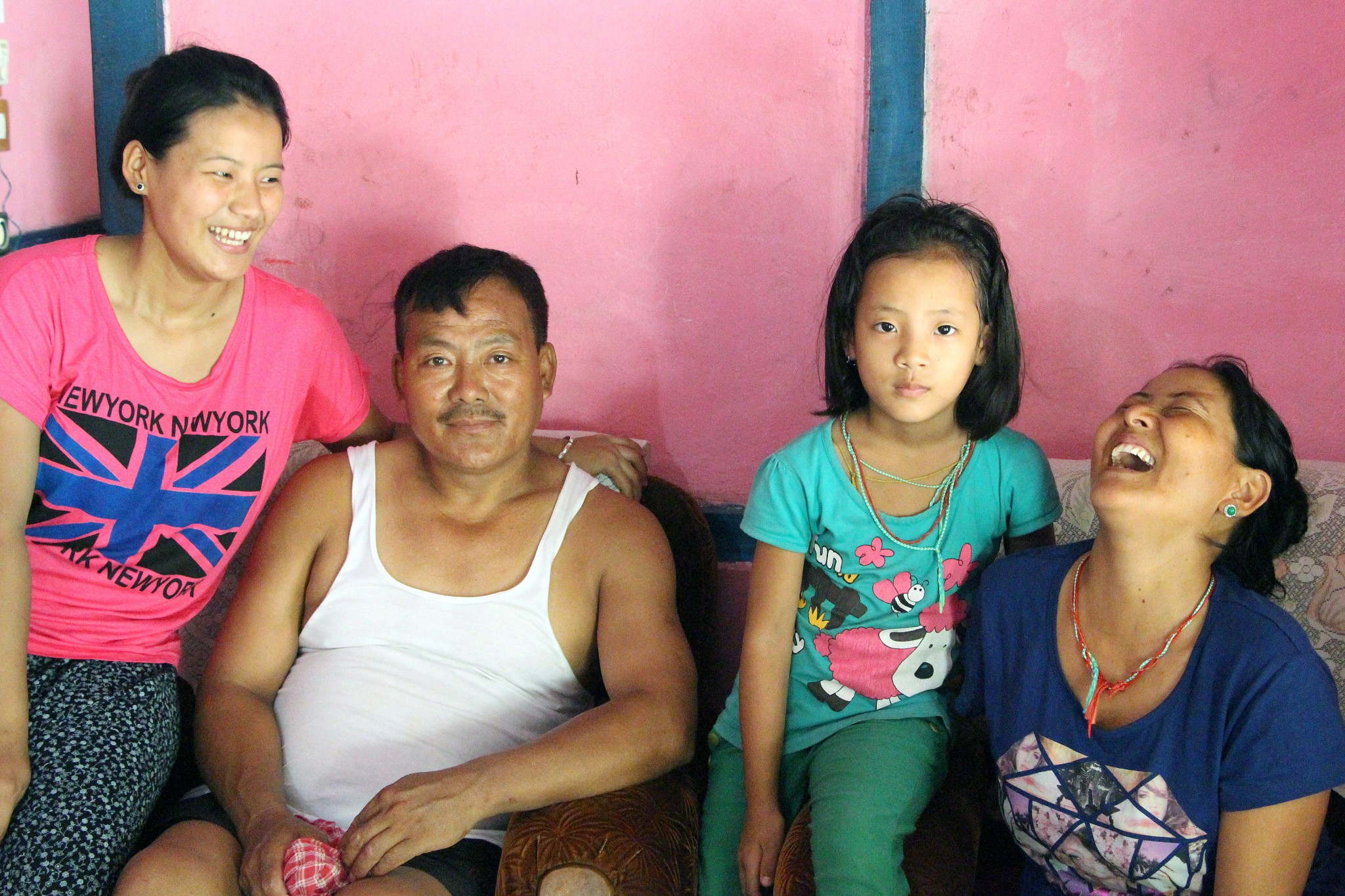 Dorjee Dolma at home with her parents and youngest sister.
